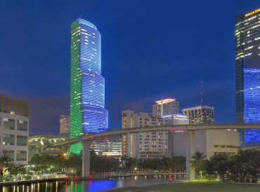 The iconic Miami Tower, pictured with blue and green lighting.